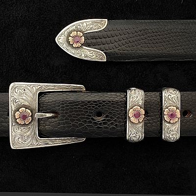 TAYLOR 1870 STERLING BUCKLE SET WITH 14K RG FLOWERS AND 4 MM RUBIES.