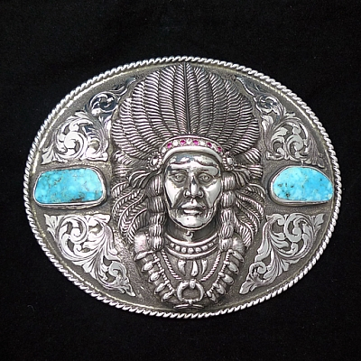 CHIEF SEVERO ROPE EDGE TROPHY WITH TURQUOISE, DIAMONDS AND RUBIES.