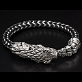 FULL CIRCLE STERLING SILVER DRAGONHEAD BRACELET WITH TOPAZ AND BRAIDED RUBBER AND STAINLESS CORD